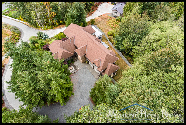 Aerial view of home nestled among trees